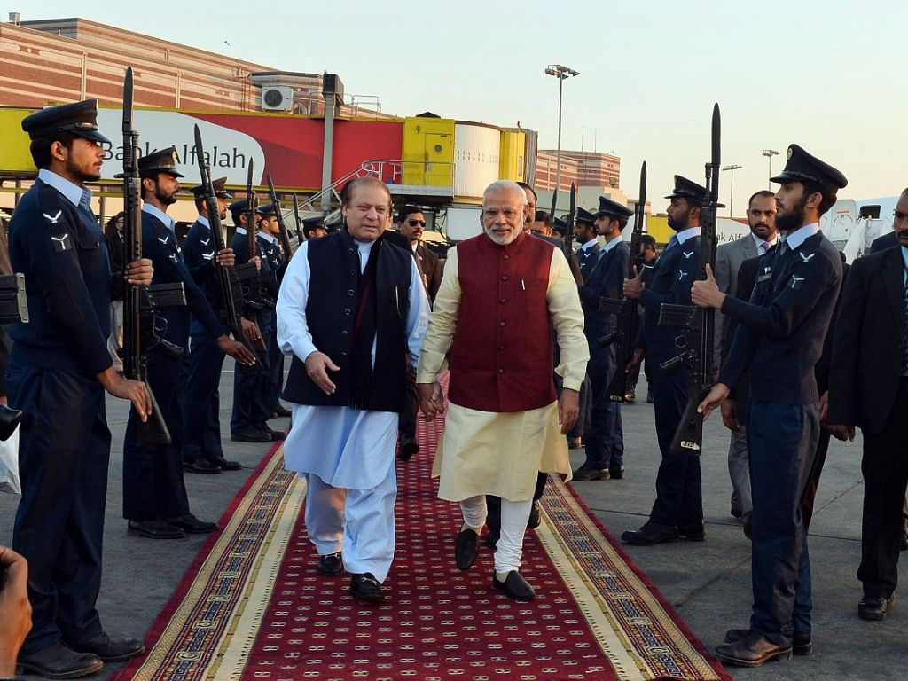 """Prime Minister Narendra Modi received by then-Prime Minister of Pakistan, Nawaz Sharif, at Lahore, Pakistan on December 25, 2015. (Photograph: PIB)<a href=""""http://pibphoto.nic.in/photo//2015/Dec/l2015122574980.jpg""""><i><br></i></a>"""
