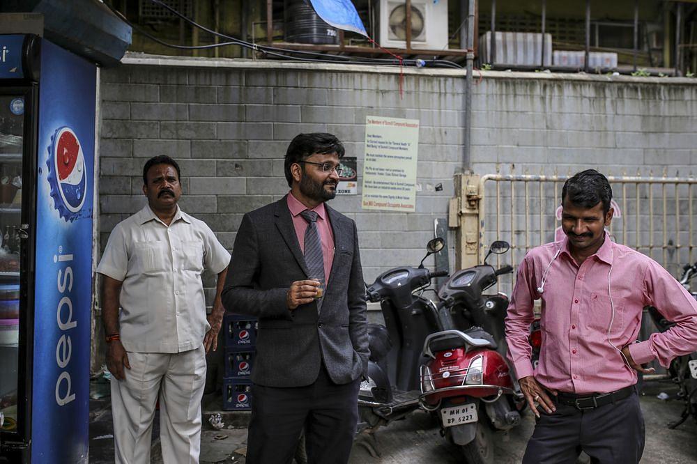 Devendra Jain, center, with his bodyguard, left, in Mumbai. (Photographer: Dhiraj Singh/Bloomberg)