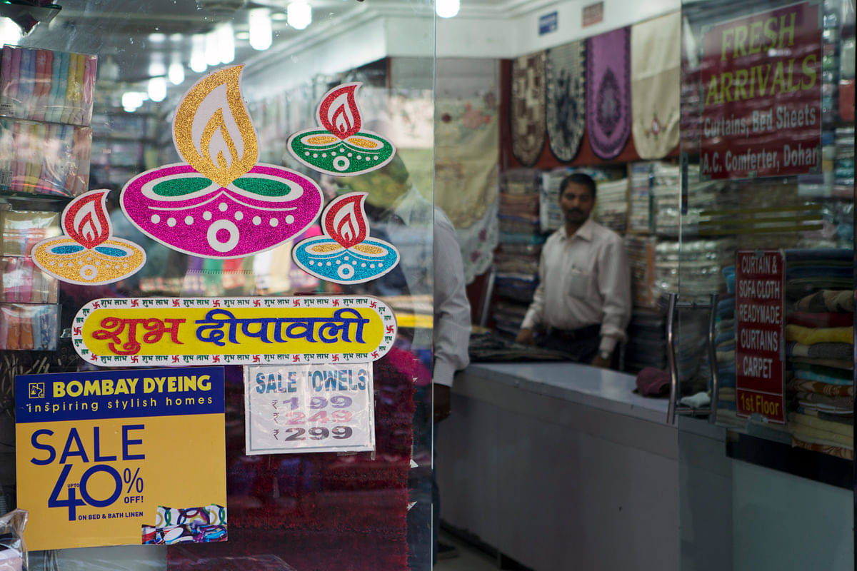 Shops display discount offers prior to Diwali at Sarojini Market, in New Delhi, India. (Prashanth Vishwanathan/Bloomberg News)