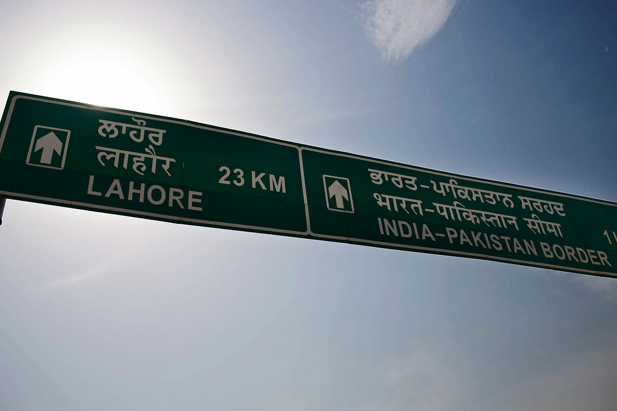A road sign for the India-Pakistan border stands in Attari, India. (Photographer: Brent Lewin/Bloomberg)
