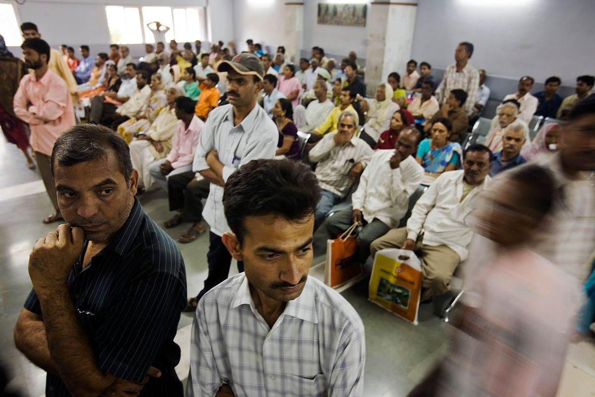 Patients wait at the Head and Neck Cancer Out Patient department of Tata Memorial Hospital in Mumbai, India. (Photographer: Prashanth Vishwanathan/Bloomberg News)