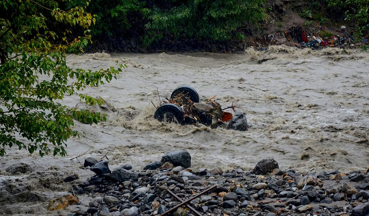 A mangled vehicle in the flash floods caused by the rains. (PTI)