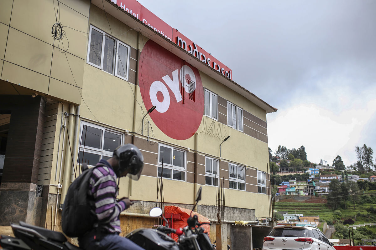 The logo of OYO Rooms, operated by Oravel Stays Pvt, is displayed outside a hotel in Ooty, Tamil Nadu, India (Photographer: Dhiraj Singh/Bloomberg)