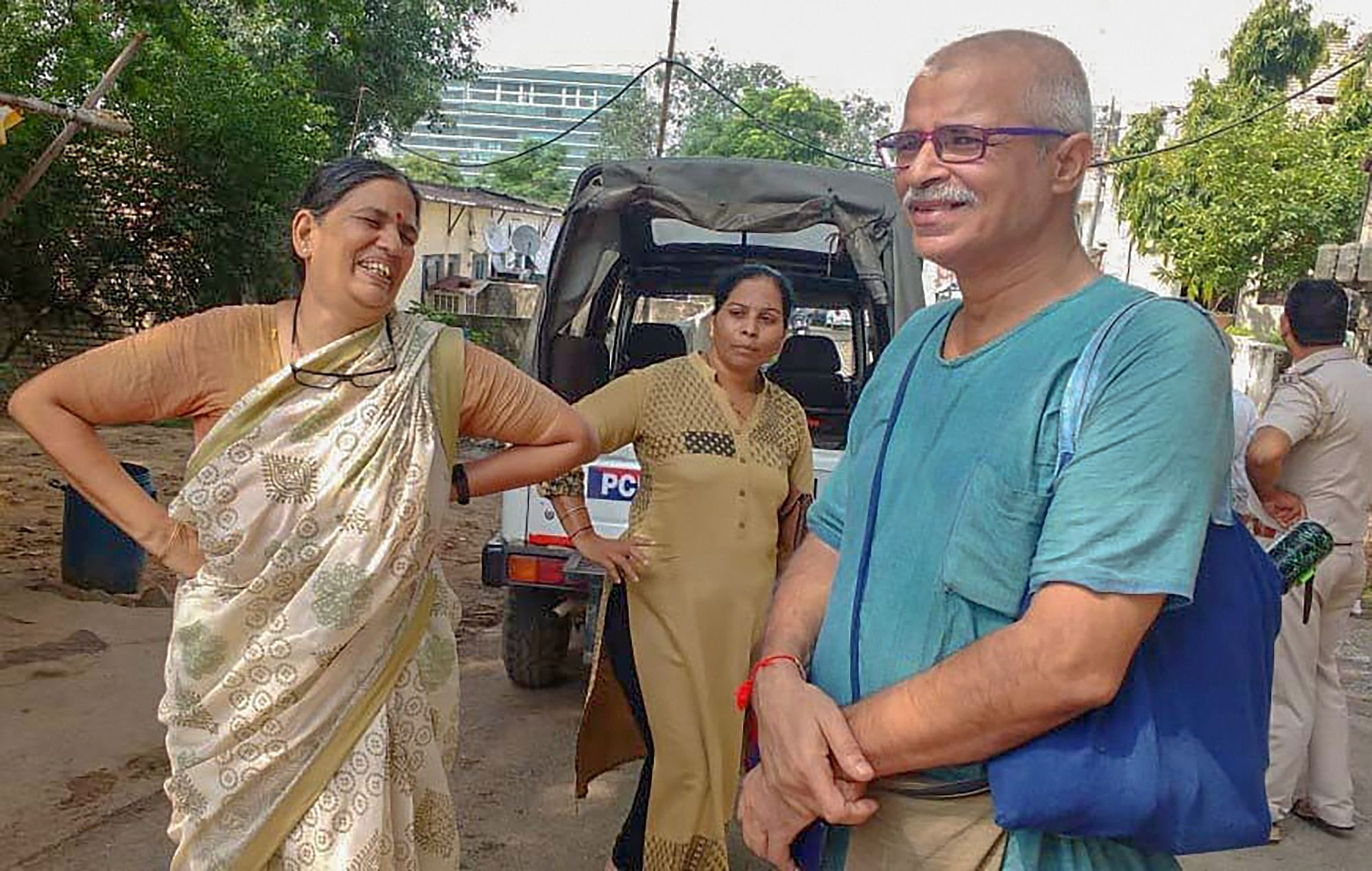 Sudha Bharadwaj (left), as she was arrested by the Pune police, in Faridabad on  Aug 28, 2018. (Photograph: PTI)