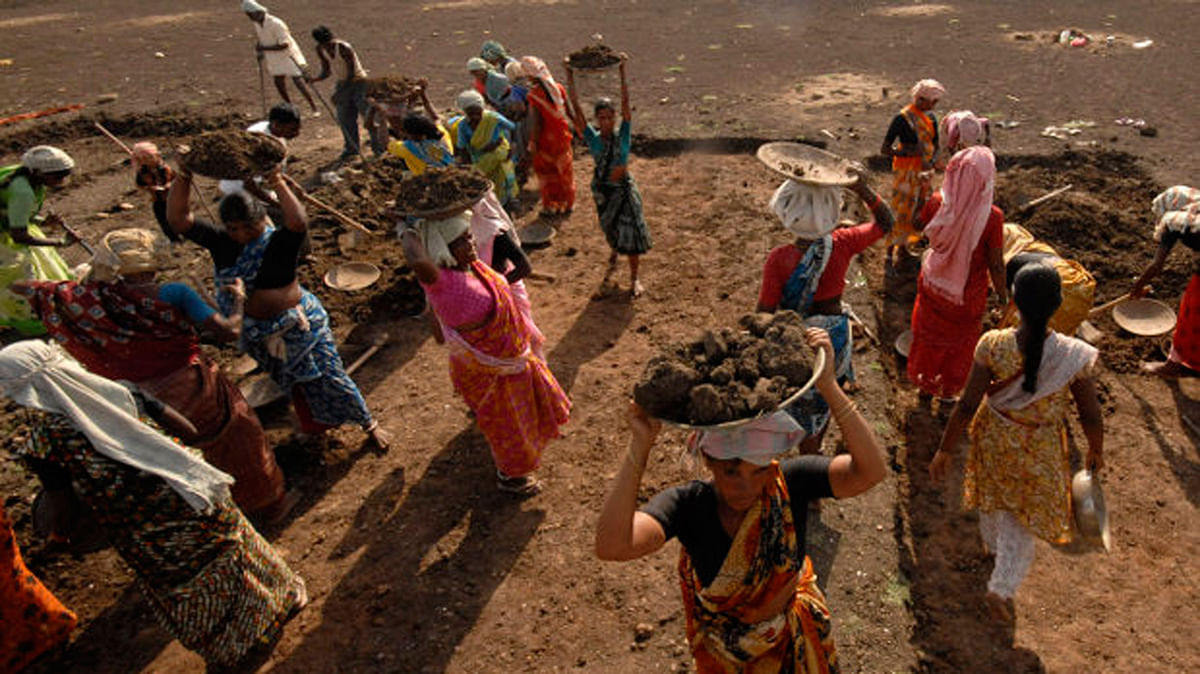 Labourers work on a dried lake to try and revive it under the Mahatma Gandhi National Rural Employment Guarantee Act (MGNREGA) on the outskirts of Hyderabad. Representational image.