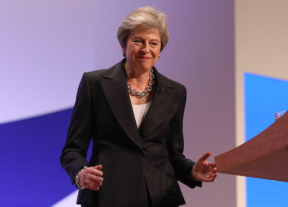 Theresa May Refuses to Dance Like Steve Bannon