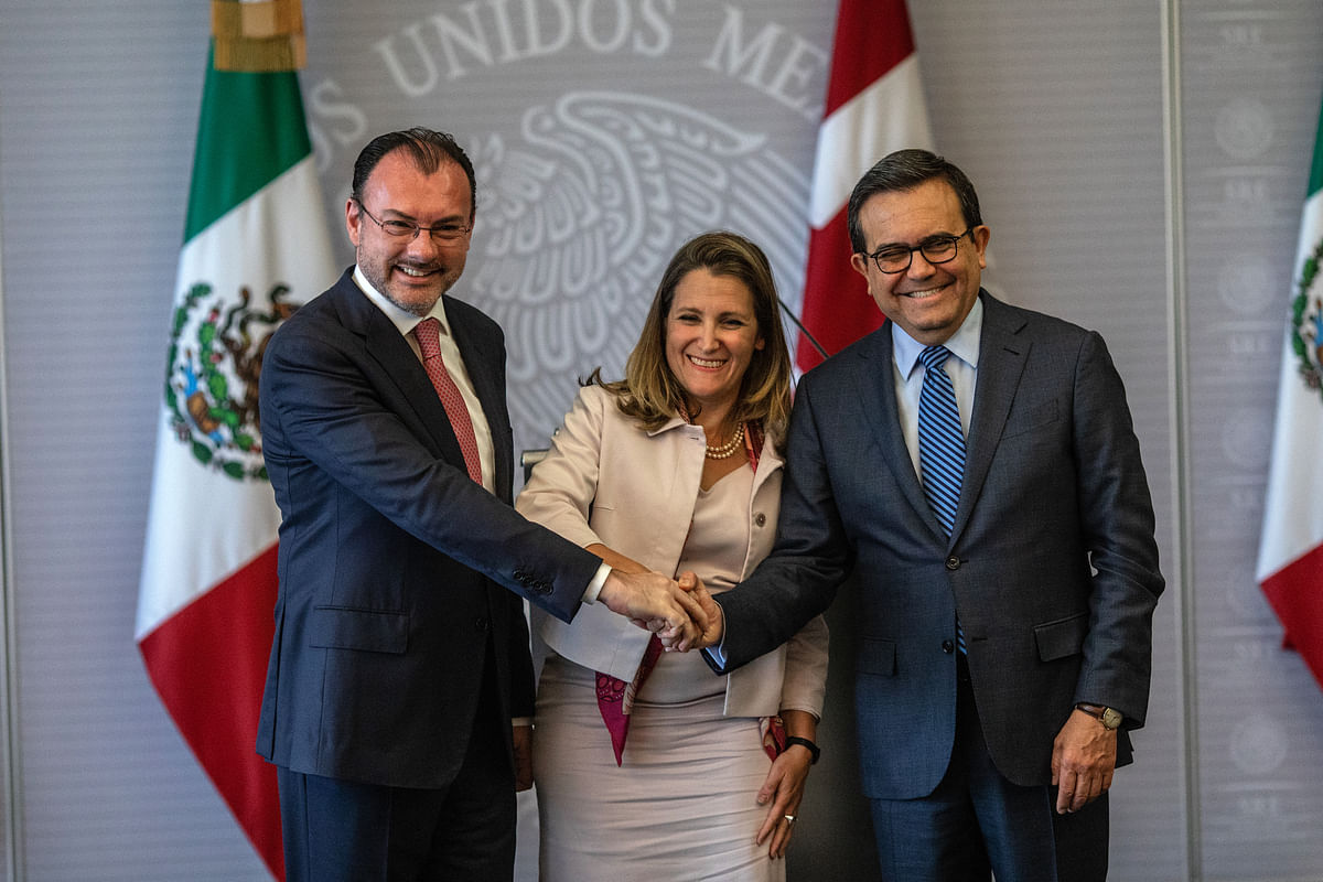 Luis Videgaray, Mexico's foreign minister, from left, Chrystia Freeland, Canada's minister of foreign affairs, and Ildefonso Guajardo Villarreal, Mexico's secretary of economy,  during a news conference in Mexico City, on July 25, 2018. (Photographer: Alejandro Cegarra/Bloomberg)