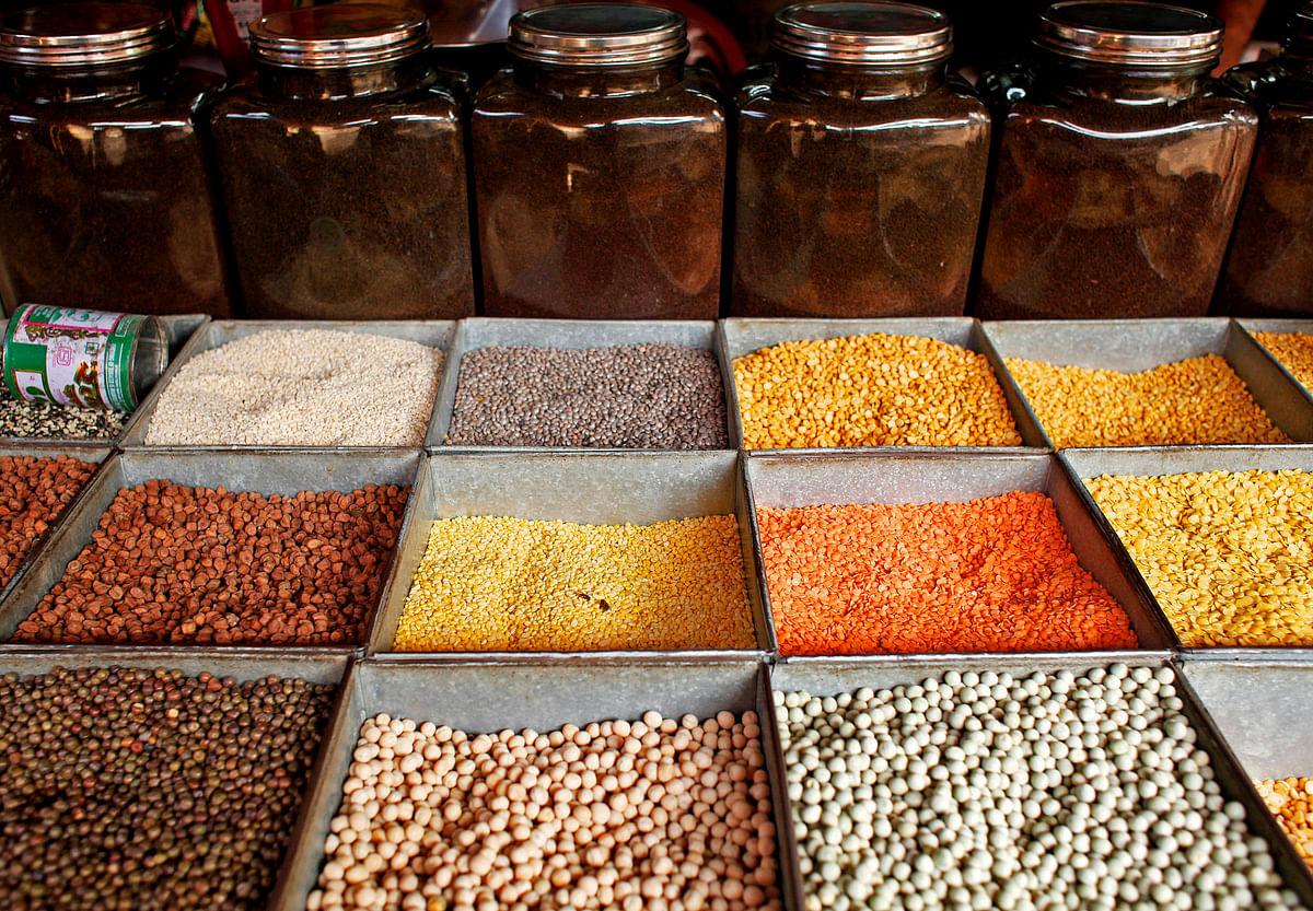 Pulses (lentils and beans) are displayed for sale at a market in Mumbai.  (Photographer: Adeel Halim/Bloomberg).