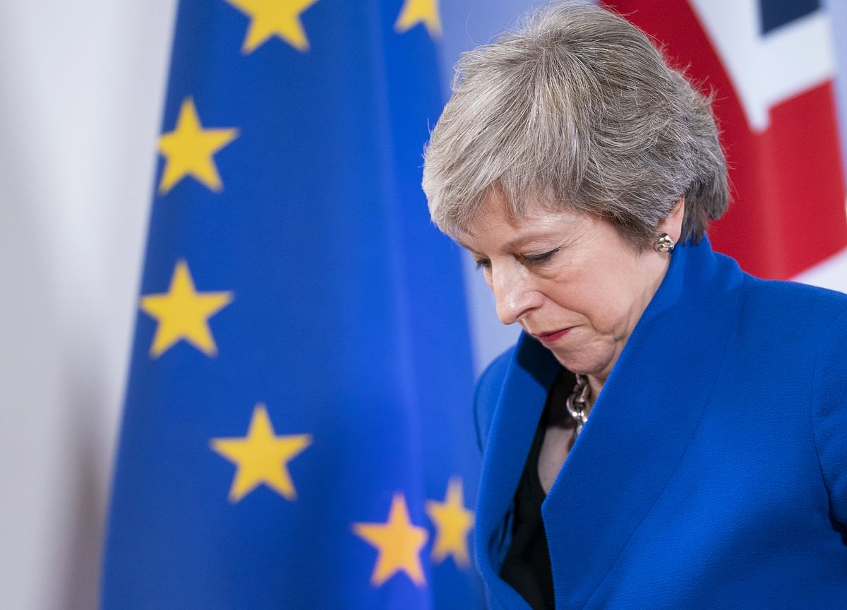 May Suffers First Brexit Defections as Three Tories Quit