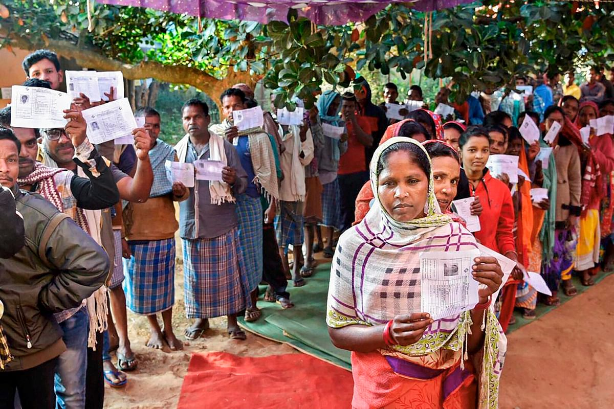 Voters wait in queues to cast their votes at a polling station in Narayanpur, Chhattisgarh, on Nov. 12,2018. (Photograph: PTI)