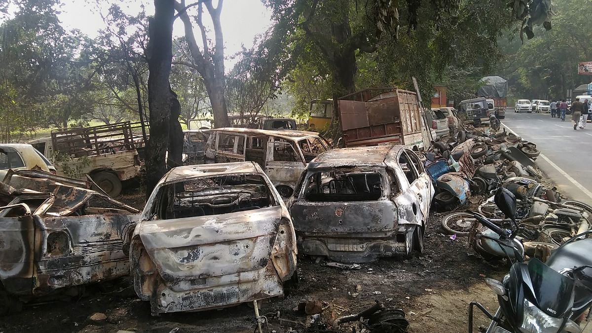 Charred vehicles which were set on fire by a mob in  violent clashes on Dec. 3, over the alleged illegal slaughter of cattle in Bulandshahr, Uttar Pradesh. (Photograph: PTI)