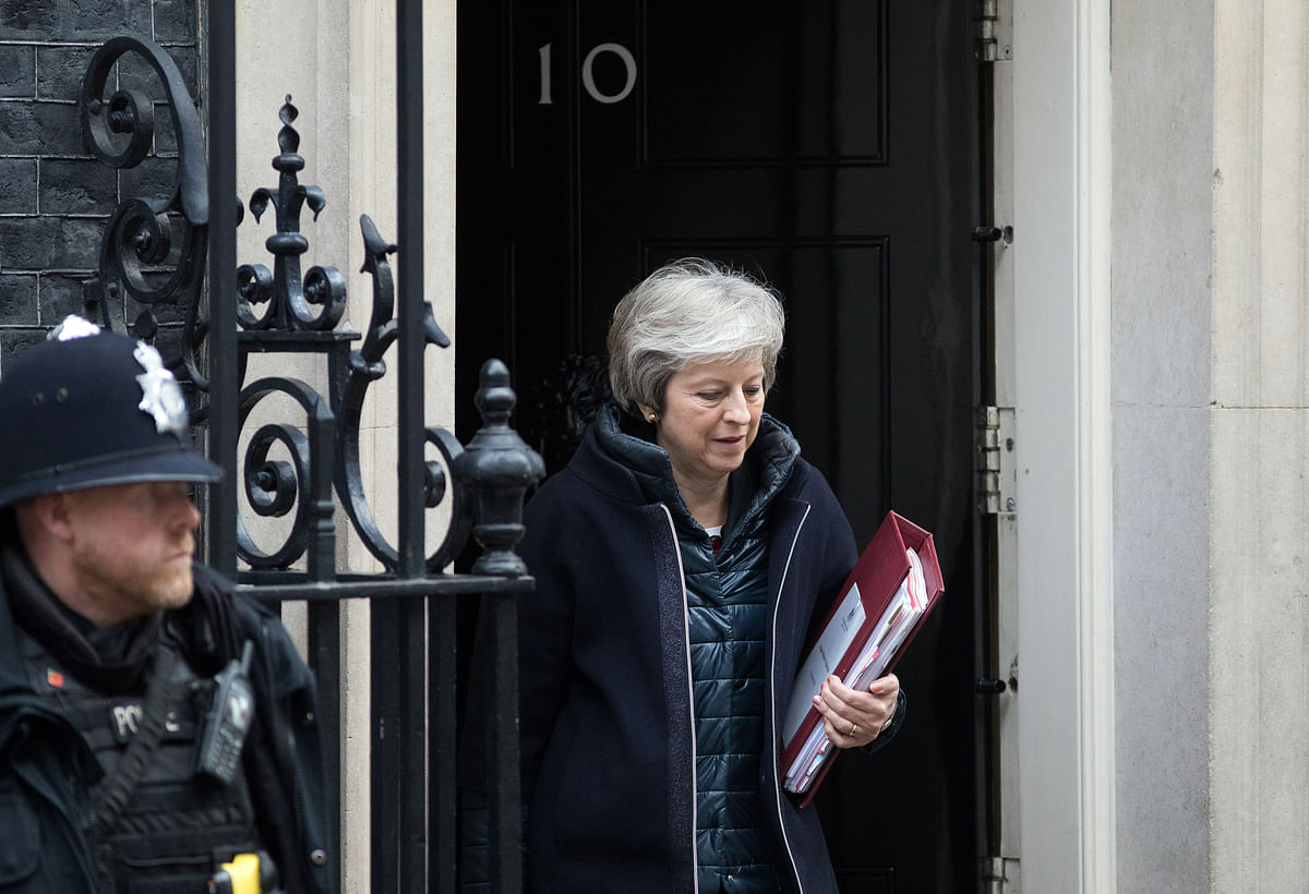 May Returns to Brexit Front Line After Surviving Tory Ambush