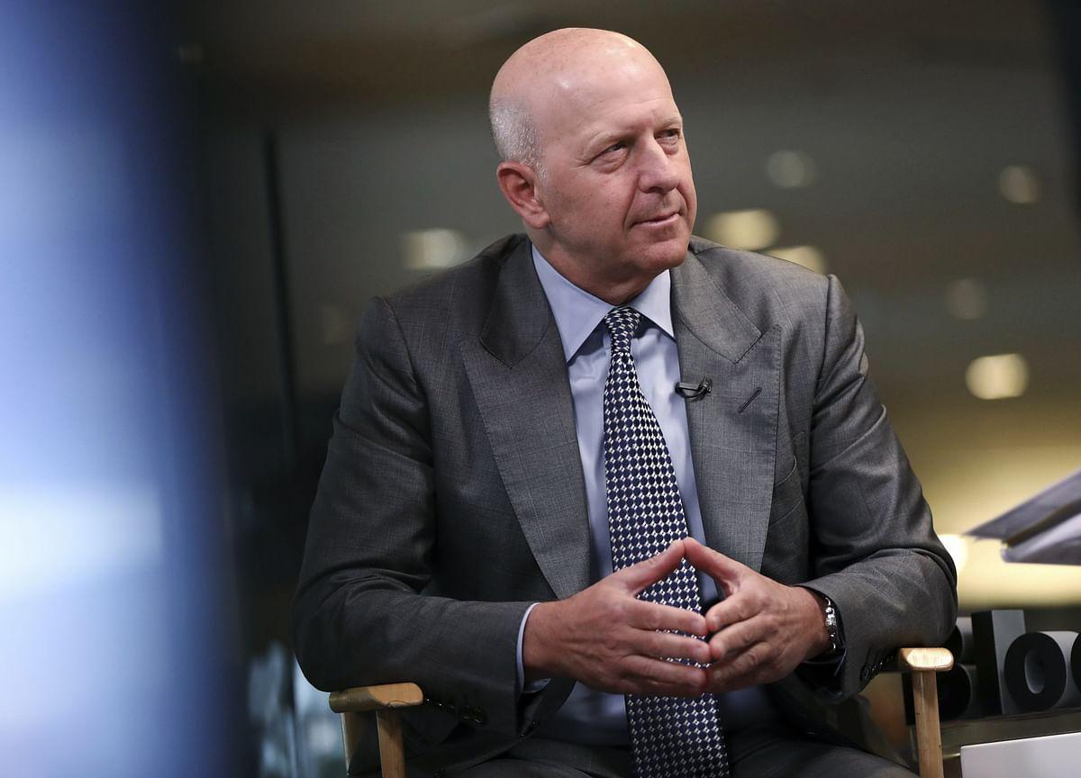 Goldman CEO's Pay Drops $10 Million on Scandal Punishment