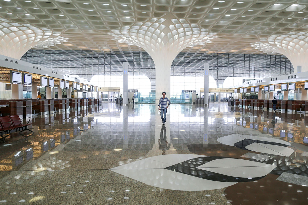 A man walks inside the newly build terminal 2 of Chhatrapati Shivaji International Airport in Mumbai, India (Photographer: Dhiraj Singh/Bloomberg)
