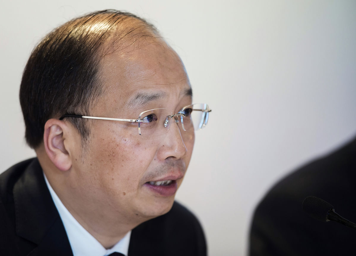 China Names ICBC's Yi as Head of Securities Regulator