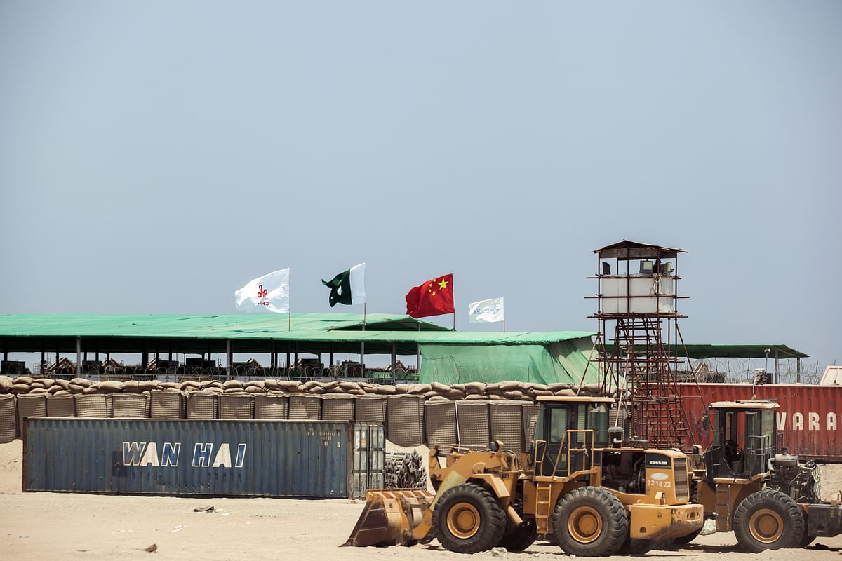 A  shipping container sits  at the Gwadar port in Pakistan. (Photographer: Asim Hafeez/Bloomberg)