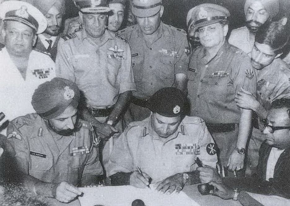 Pakistan's Lt. Gen. AAK Niazi signing the  Instrument of Surrender, while India's Lt. Gen. JS Aurora looks on, in Dhaka, on Dec. 16, 1971. (Photograph: Indian Navy)