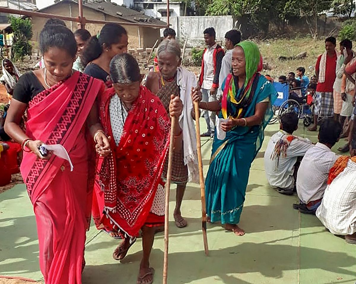Elderly voters arrive to cast their votes at a polling booth  in Sukma, Chhattisgarh. (Photograph: PTI)