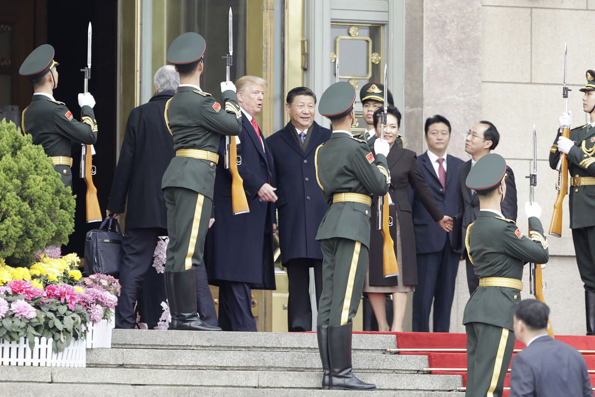 Donald Trump  and Xi Jinping  outside the Great Hall of the People in Beijing, China. (Photographer: Qilai Shen/Bloomberg)