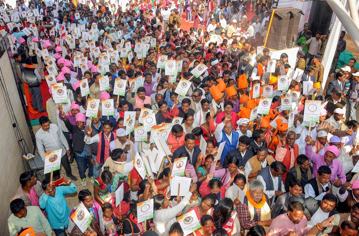 Tribals from across Jharkhand  take part in 'Martyr Mitti Yatra' in Ranchi. (Photograph: PTI)