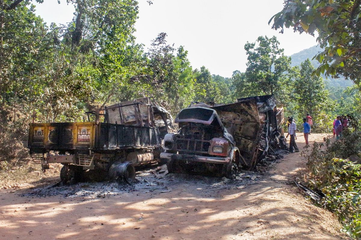 Charred vehicles which were allegedly torched by Maoist rebels during a bandh. (Photograph: PTI)