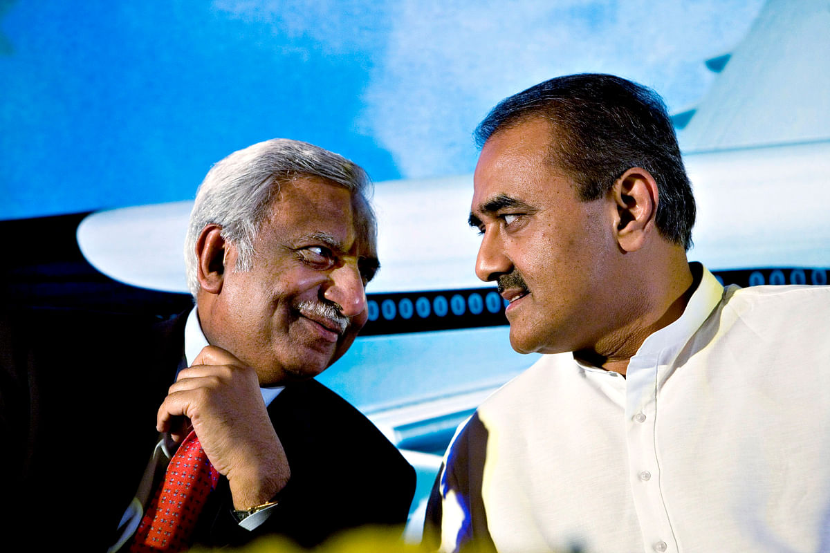Naresh Goyal speaks with Praful Patel, then India's minister of aviation, at a news conference. (Photographer: Sanjit Das/Bloomberg News)
