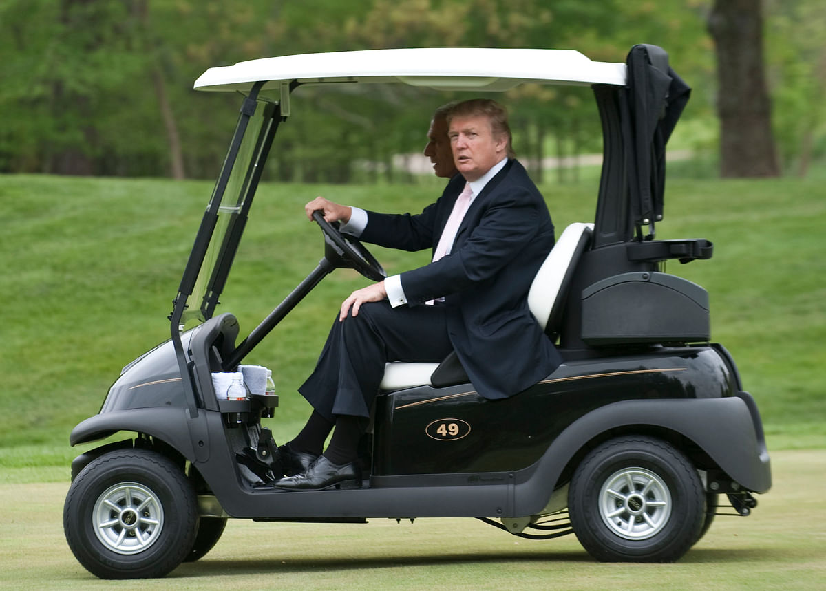 Donald Trump drives a golf cart  in Potomac Falls, Virginia. (Photographer: Mannie Garcia/Bloomberg News)