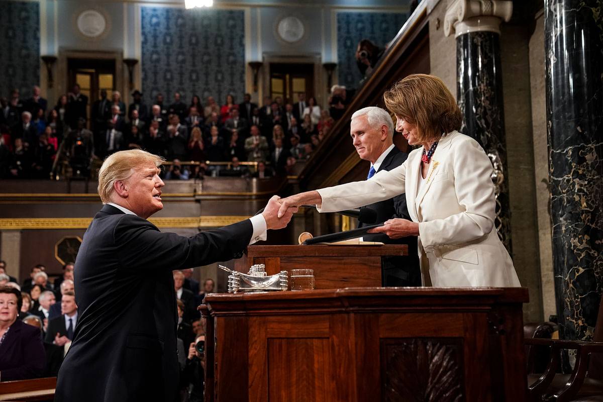 U.S. President Donald Trump shakes hands with U.S. House Speaker Nancy Pelosi, in Wasthington D.C., on Feb. 5, 2019. (Photographer: Doug Mills/Pool via Bloomberg)