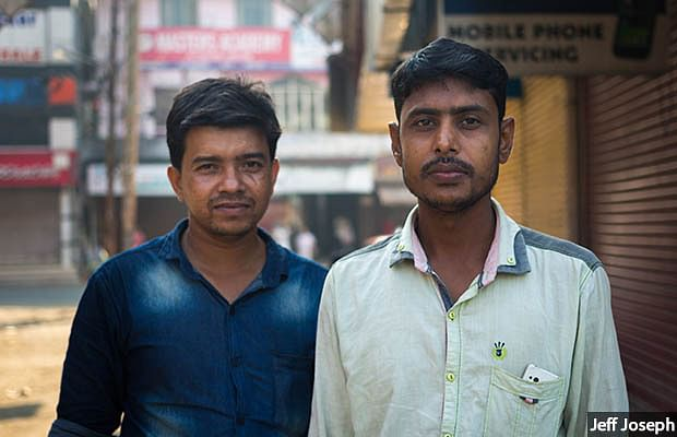 """Feroz Shaikh (left), a labour contractor, moved to Kerala from Bengal 19 years ago. Factory owners asked for 15-20 workers per unit before demonetisation, he says. Now, they ask for five. """"There is no work."""" Raju (right), a mason's helper, also from Bengal, shares a room with 10 others. His income is down by a third since demonetisation and he finds work two days a week, down from five. There is no money to send home."""