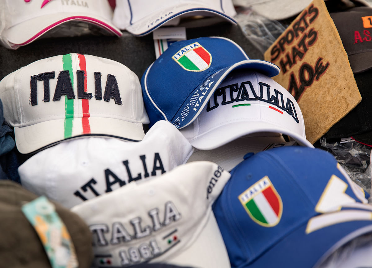 Italy Output Shrank Less Than First Seen, Still in Recession