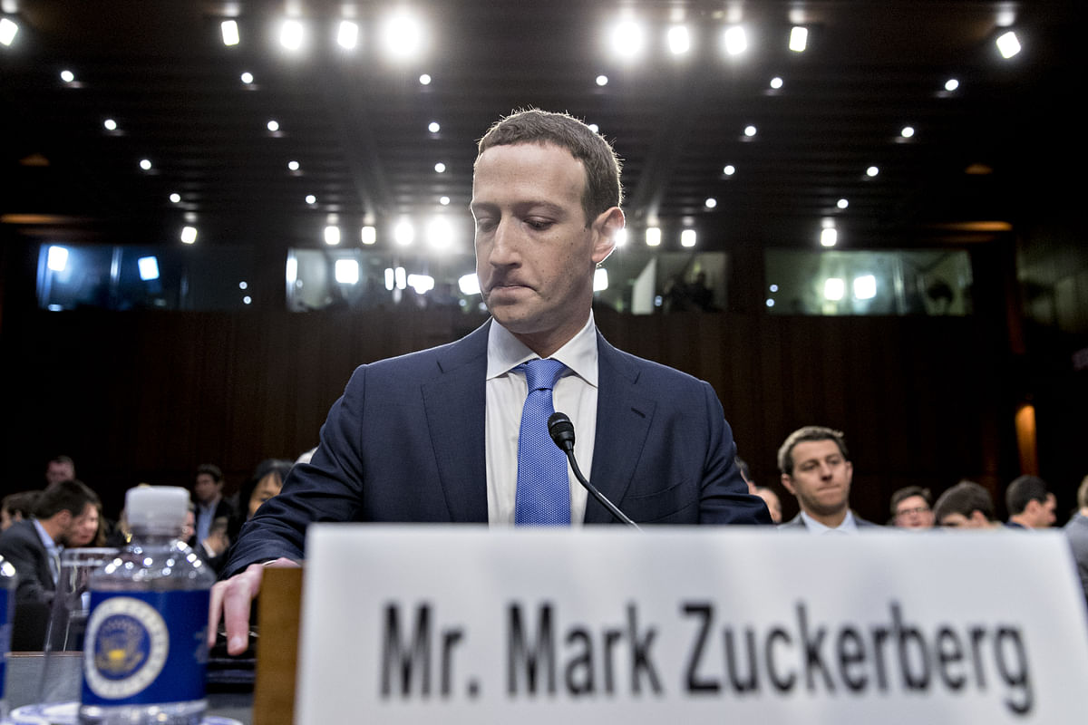 Lawmakers will grill Zuckerberg on issues ranging from the troves of data vacuumed up by app developers and political consultant Cambridge Analytica to Russian operatives' use of the social network to spread misinformation. (Photographer: Andrew Harrer/Bloomberg)