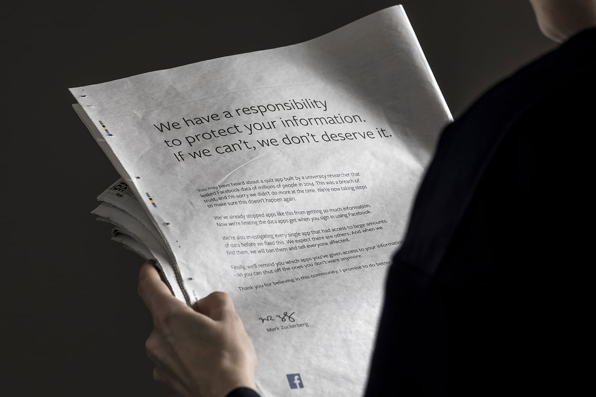A Facebook Inc. advertisement is displayed on the back page of the Sunday Mirror newspaper. (Photographer: Jason Alden/Bloomberg)