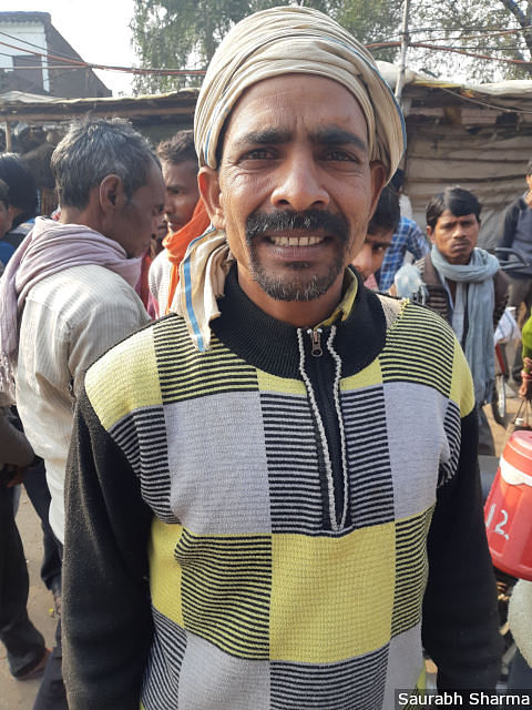 Ram Baran, a daily wage labourer, is one of many at the labour hub to express disappointment with the ruling government.