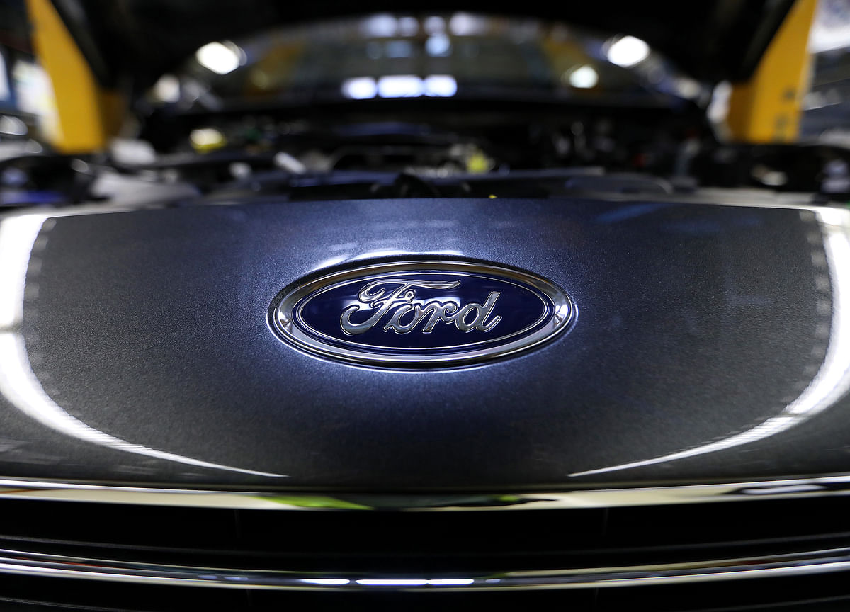 Ford Climbs Back Above $10 on `Rolling Stone' of Improvements