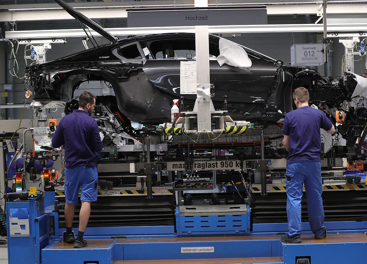 Germany Suffers Double Blow on Factory Slump, Downgrade