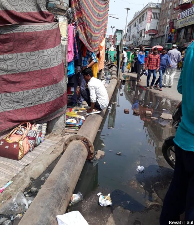 Sewage flows along the ghats of Varanasi. The city has only half the sewage lines it needs, government data show.
