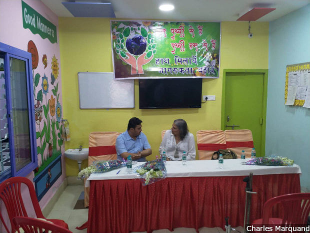 """Vaibhav Kapoor (left), Bharatiya Janata Party leader and head of the party's social media campaign, speaks to your reporter at a primary school in Varanasi. """"I don't fake things,"""" Kapoor says. """"Sometimes, if I don't want to speak the truth, I can tell you the extended truth. But I don't lie."""""""