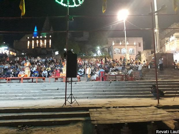 Devotees gather to watch the evening <em>aarti</em> or prayers, on the ghats alongside the Ganga.