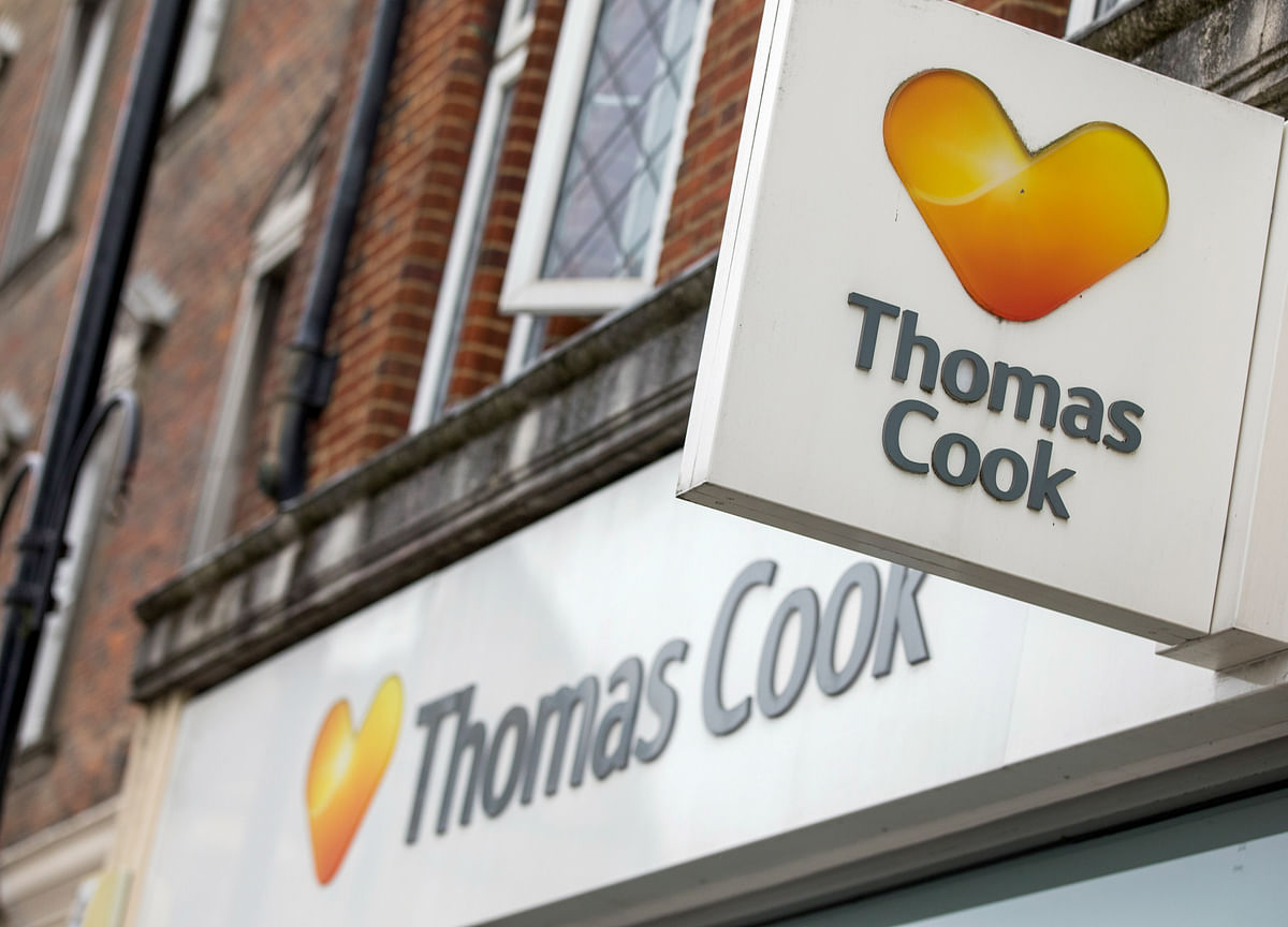 Thomas Cook Shares Slump as Losses Mount