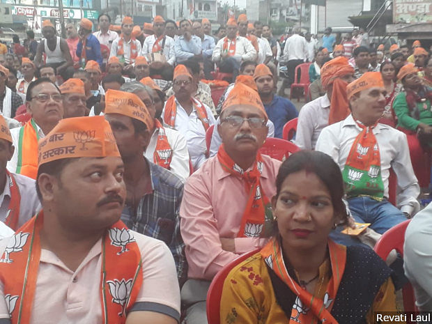 Supporters of the BJP sport the party's campaign material at a rally in Hardoi town addressed by Prime Minister Narendra Modi and the party's candidate for Misrikh constituency Ashok Rawat.