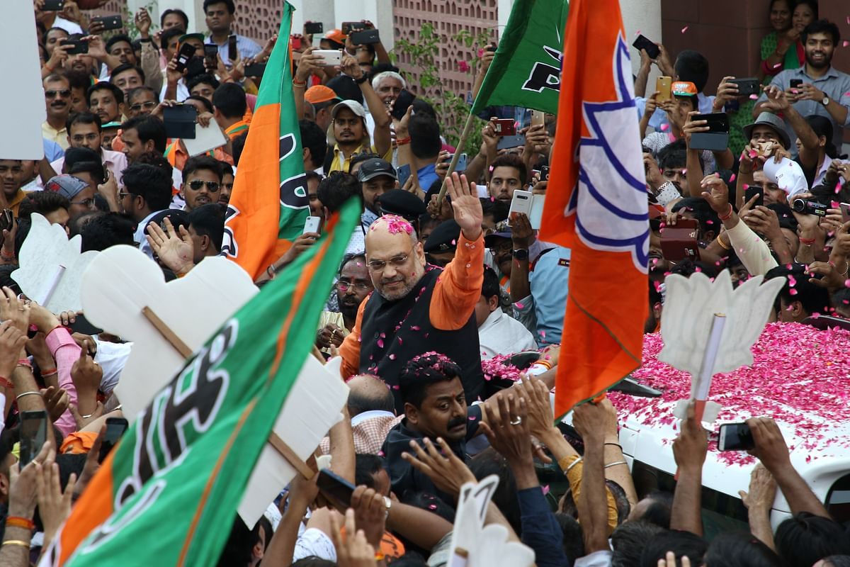 Amit Shah celebrates during an event at the party's headquarters in New Delhi. (Photographer: T. Narayan/Bloomberg)