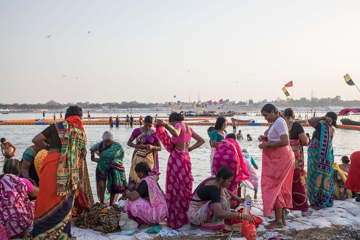 In Prayagraj, pilgrims visit the Triveni Sangam, where the Ganges meets the Yamuna and Saraswati rivers. (Photographer: Anshika Varma for Bloomberg Businessweek)