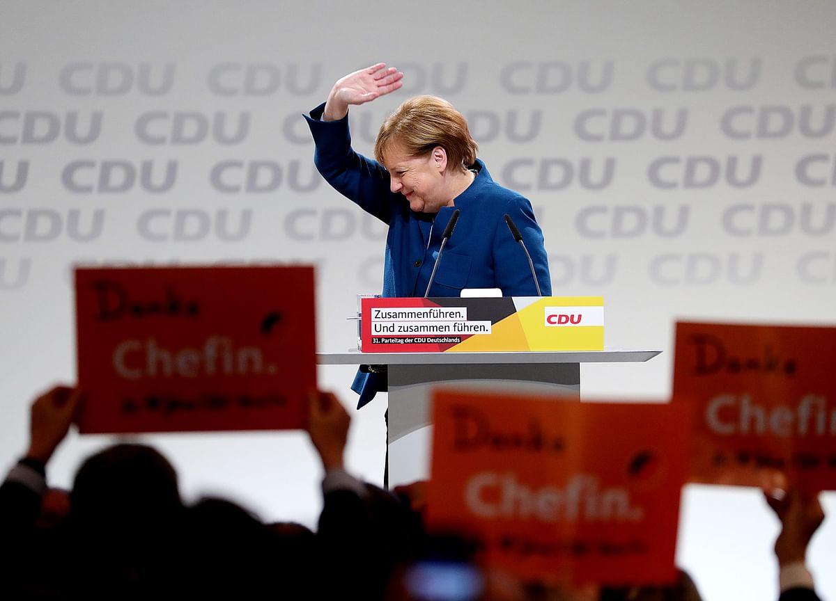 Merkel Has Harvard Cheering Attack on Trump Politics of Lies
