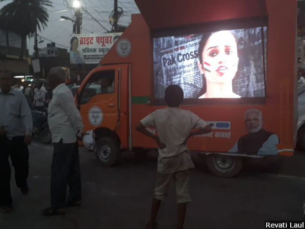 A screen mounted on a carrier plays campaign videos of the Bharatiya Janata Party in Lucknow. The constituency has unfailing voted for the Bharatiya Janata Party since 1991.