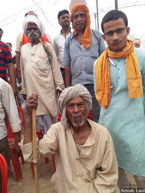 "Harikesh Singh (right), a Bharatiya Janata Party (BJP) minder in the crowd at Prime Minister Narendra Modi's rally in Bhadohi. ""I am not in the BJP or a <em>bhakt</em> (fan),"" he says; ""but I am with the <em>sachhe insaan-</em>-the honest man--<em>mannaniya Modi ji</em>, respected Modi<em>ji</em>."""