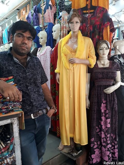 """Himanshu Khanchandani's Jeewan Stores sells nighties for women along the ghats in Varanasi. A Modi fan, he has no time for claims that demonetisation and the goods and services tax hit small businesses like his. Outside the frame, other shopkeepers say """"Modinomics"""" hit them hard."""