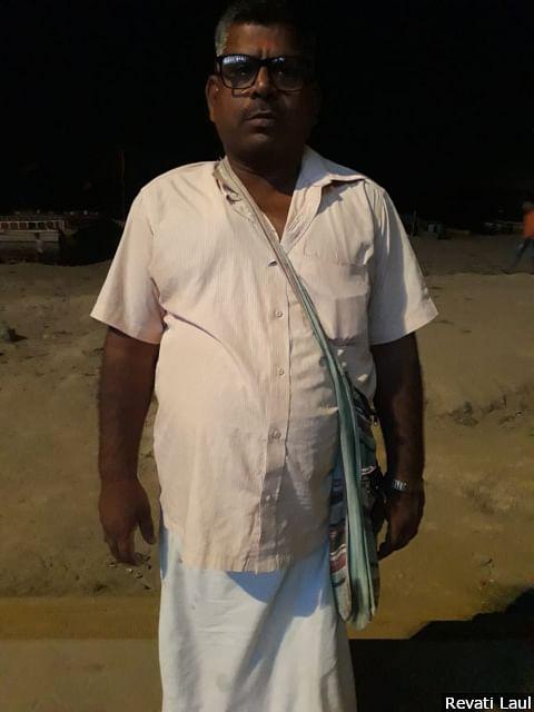 "In a quiet corner along the Tulsi ghat, Mangal Yadav chanted the Hanuman <em>chalisa </em>or prayer to Lord Hanuman. ""<em>Dharam ko vyapar bana diya</em>,"" he says, blaming right-wing organisations for converting faith into a business."