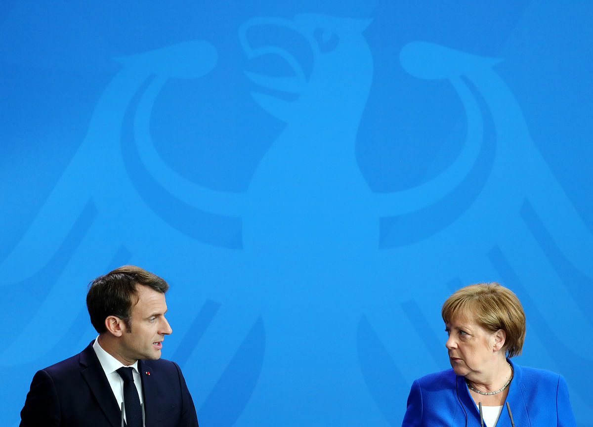 Macron and Merkel at Odds Over EU Jobs, Decision Due End of June
