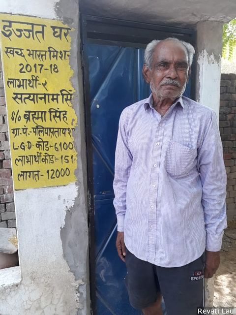 Ram Tirath, 55, stands next to the toilet he built with the assistance of the government's Swachh Bharat scheme, at his home in Palia Pratap Shah in the western Uttar Pradesh district of Faizabad. There is no question of voting for anyone besides the Bharatiya Janata Party and Prime Minister Narendra Modi, he says.