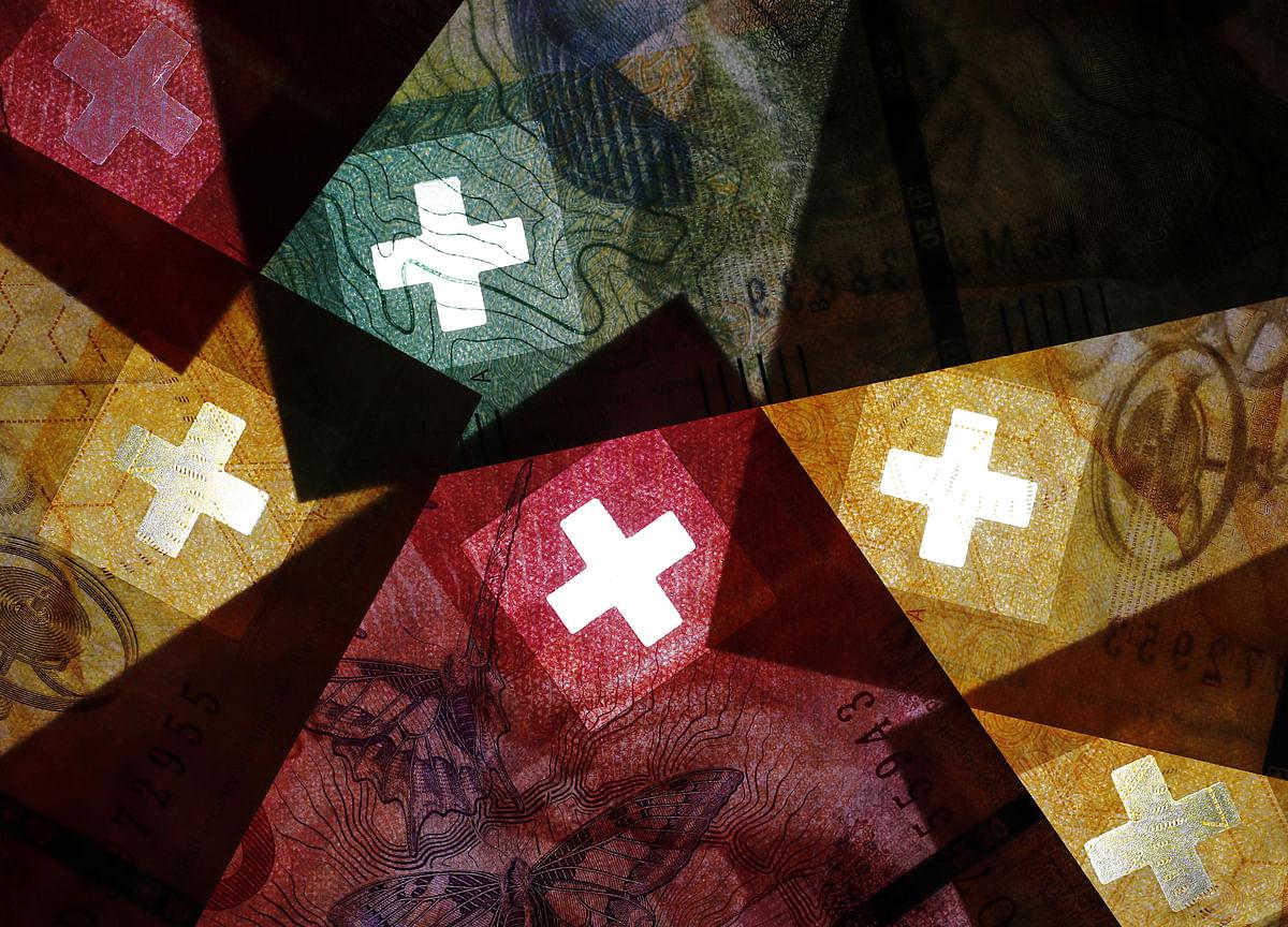SNB's Old Threat Returns as Federal Reserve, ECB Go Dovish